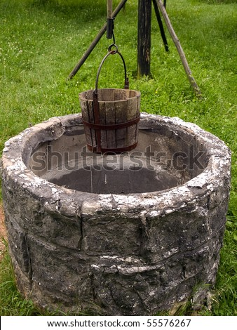 old draw-well in historical czech village - stock photo