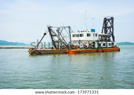 Old dredge in the bay. Thailand - stock photo