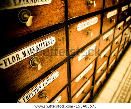 old drugstore with a lot of cabinets - stock photo