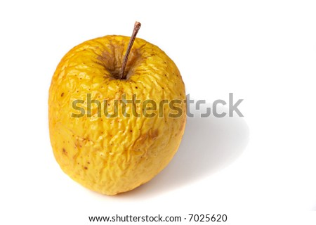 old dry ribbed apple with shadow - stock photo