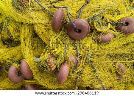 Old dry yellow fishing nets - stock photo