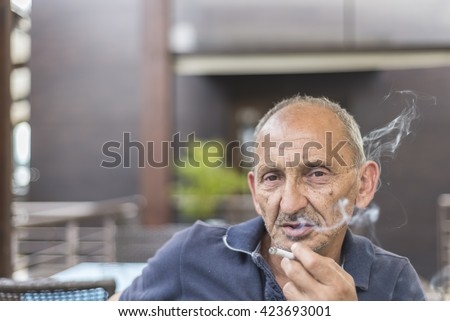 old  dude  enjoy in  his  cigarette - stock photo