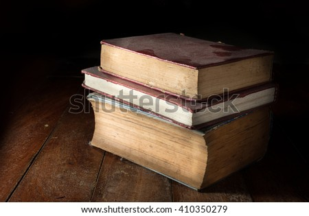 Old dusty books on table. - stock photo