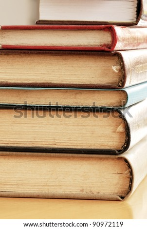 old dusty closed books stack on table - stock photo