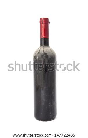 Old dusty wine bottle on white background - stock photo