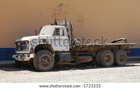 old dusty wreck truck,  weathered brown wall background