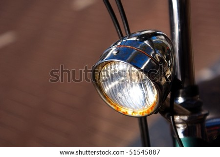 old dutch bicycle's rusted lamp - stock photo