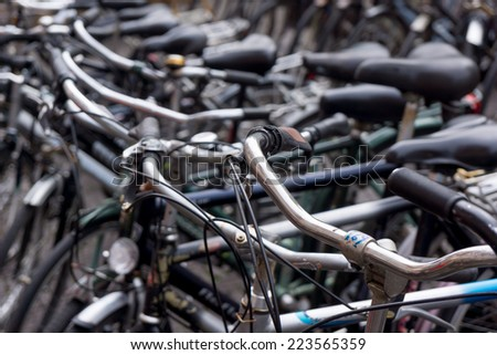 Old Dutch bikes are sold at a flea market Waterlooplein in Amsterdam - stock photo