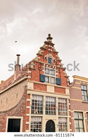 Old dutch houses in old dutch village. Enkhuizen an old fishermen town. - stock photo