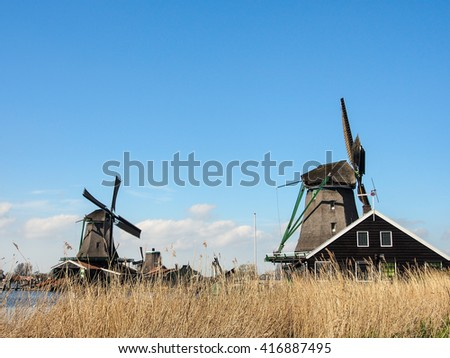 old Dutch traditional windmill at Zaanse Schans, Netherlands - stock photo