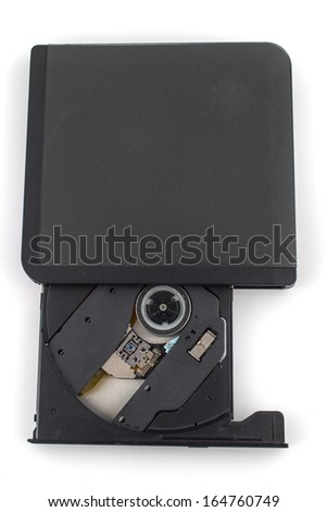 old DVD-ROM in drive on white - stock photo