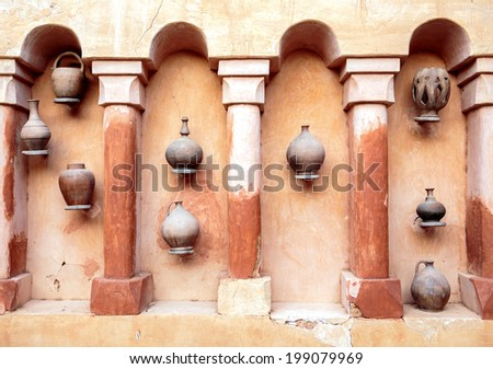 Old earthenware crockery and set of arches in Agadir, Morocco - stock photo