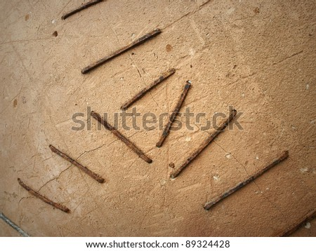 old earthenware jar with crack and cramps - stock photo