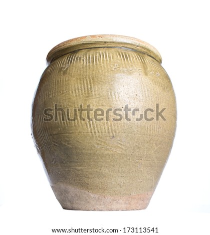 Old earthenware storage jar over white background