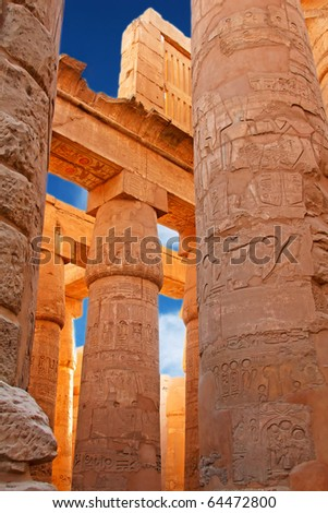 old egypt hieroglyphs carved on the columns of Karnak temple (Valley of kings, Egypt) - stock photo