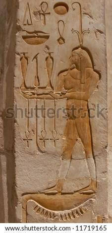 Old egyptian bas-relief and hieroglyphs, Hatshepsut, Luxor, Egypt - stock photo