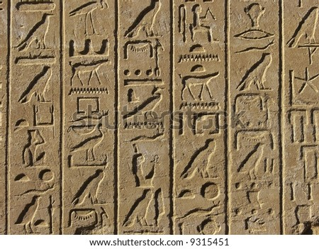 Old egyptian basrelief and hieroglyphs background