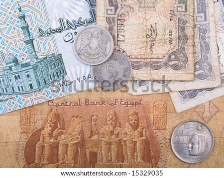 Old Egyptian currency banknotes and coins - stock photo