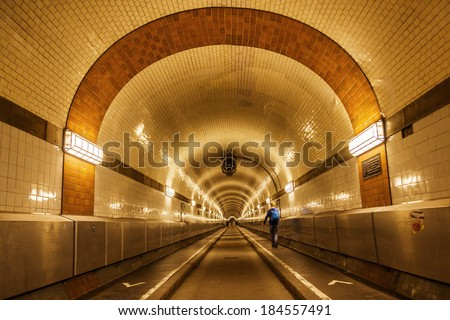 old Elbe tunnel in Hamburg, Germany, which connect St Pauli with the docks and shipyards of the Hamburg harbor - stock photo