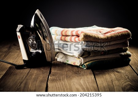 Old electric iron, touch-up in retro style - stock photo