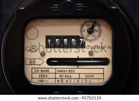 Old electric meter close up - stock photo