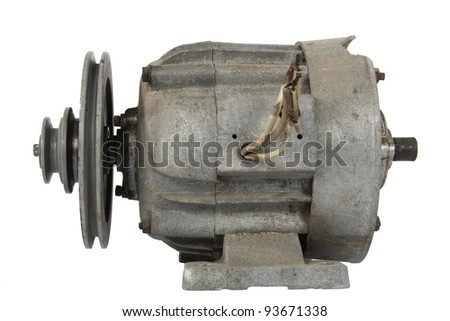 Old electric motor with a pulley, isolated on white background - stock photo