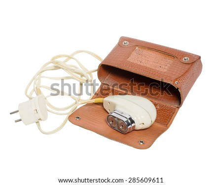 Old electric shaver on a white background. box. isolated