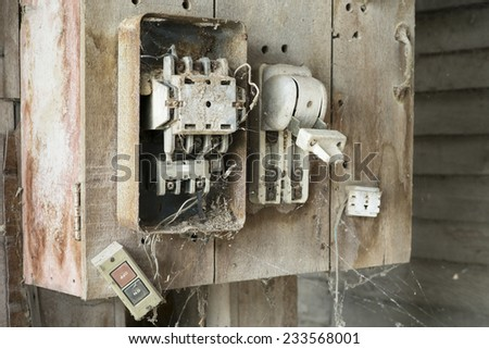 Old Electric Switch on wood plate - stock photo