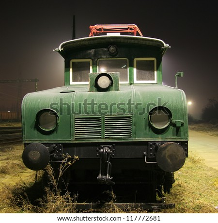 Old electric train at evening - stock photo
