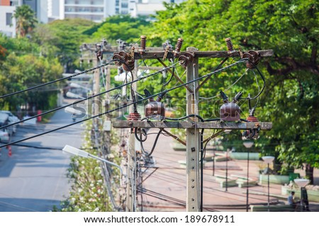Old electrical cables in Bangkok city - stock photo