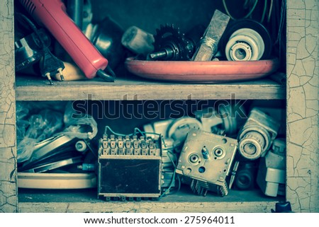Old electrical junk in shelf - stock photo