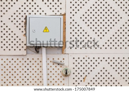 old electrical panel on wall - stock photo