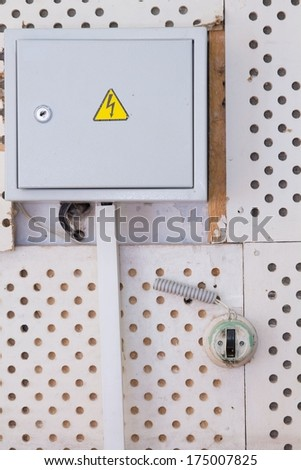old electrical panel on wall closeup  - stock photo