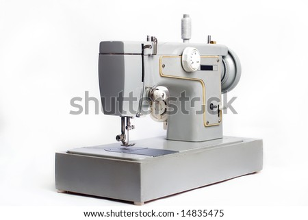 Old electrical sewing machine isolated on white - stock photo