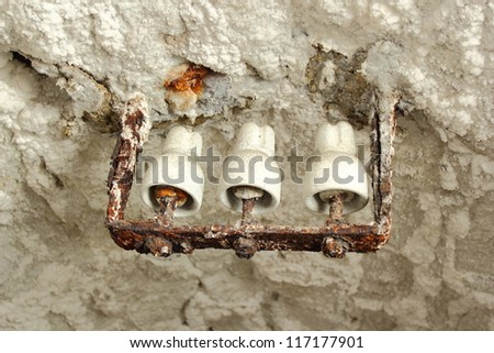 old electricity equipment in a salt mine ; the salt has drained off from the tunnel ceiling - stock photo