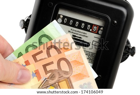 Old electricity meter and Euro-banknotes in front of a white background - stock photo