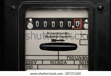 Old electricity meter in front of a white background - stock photo