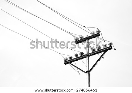 old electricity or telegraph pole, white wire and cables
