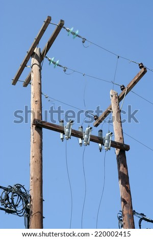 Old electricity transformer. Old wooden post with electric power transformer. - stock photo
