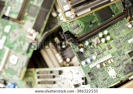 Old electronic circuit boards of computers in disuse. Computer motherboards with processors, resistors, capacitors and other electronic parts. Concept of computer evolution and innovation - stock photo