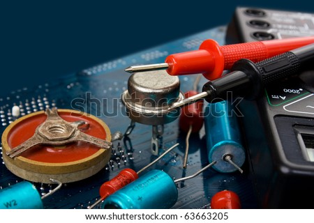 old electronic components and printed circuit board - stock photo
