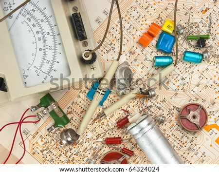 Old electronic components lie on the wiring diagram - stock photo