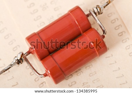old electronic components on a background of the old punch card - stock photo