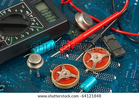 old electronic components on printed circuit board - stock photo