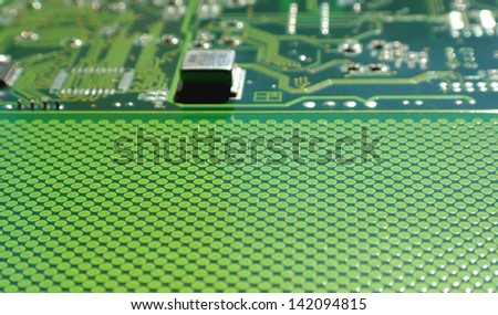 Old electronics circuit board for printer over white, shallow dof - stock photo