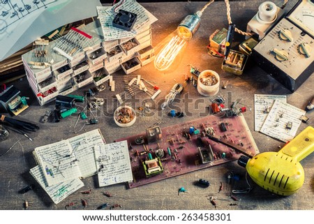 Old electronics workplace in laboratory - stock photo