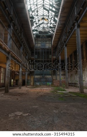 Old elevator in a large deserted hall - stock photo