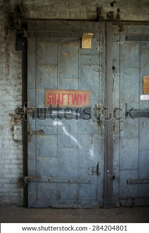 Old elevator shaftway - stock photo