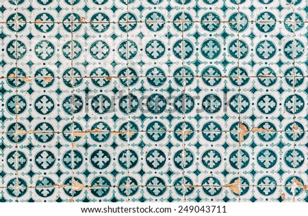 Old emerald azulejos on the building's exterior in Lisbon, Portugal. - stock photo