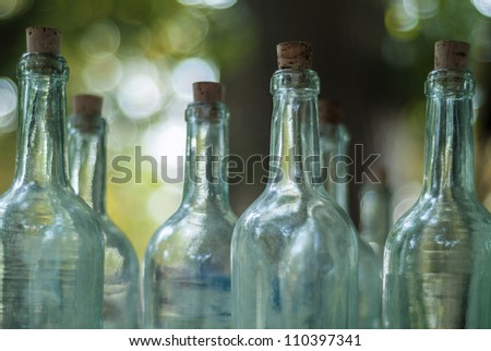 Old empty bottles on an outdoor antique market